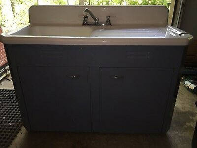 antique double bowl farm sink with original stand and dish board