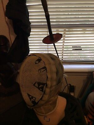 antique fencing mask and sword
