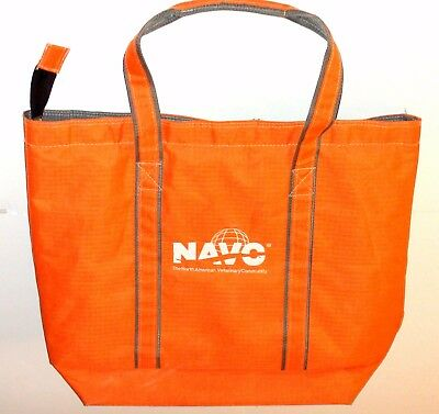 Orange veterinary bag with handles, inside pouches with velcro