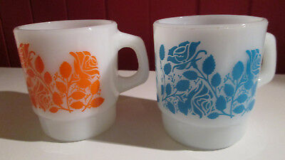 "Lot of 2 Anchor Hocking ""rose"" pattern coffee mugs milk glass orange and blue"