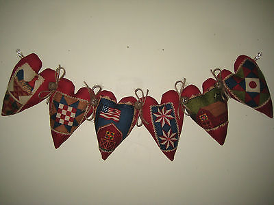 6 Patriotic red appliqued hearts sewn into 20 in. garland American Home Decor