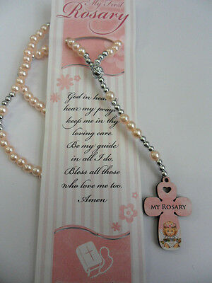 Baby's First Rosary Beads. Elasticated rosary beads on a card with prayer. Pink