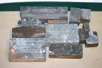 13 x Vintage Metal Printing Plates on Wooden Blocks companies, seals and badges