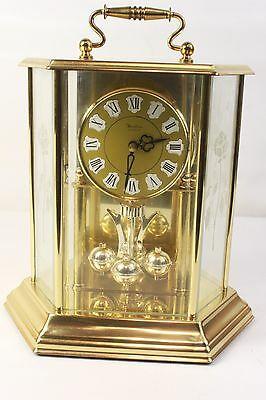 HEIRLOOM, quartz anniversary clock in glass case. (ref 916)