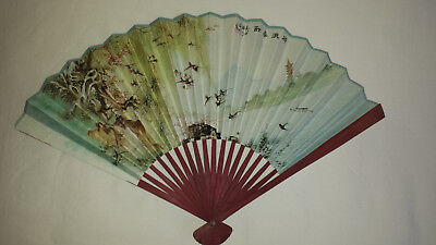 Chinese paper fan with bamboo sticks and guard