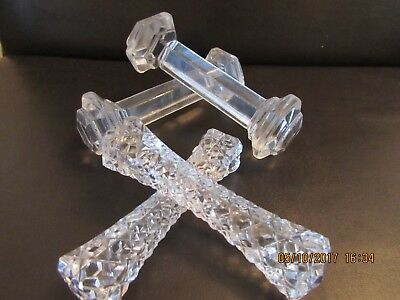 Two pairs of glass knife rests