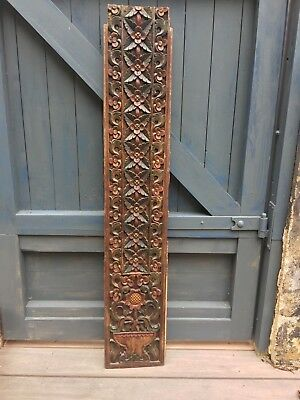 Antique ornately carved and painted teak wood panel from Javanese canopy bed