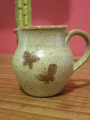 A BEAUTIFUL JUG WITH 2 BUTTERFLIES PRINTED .. ( Clay i think )