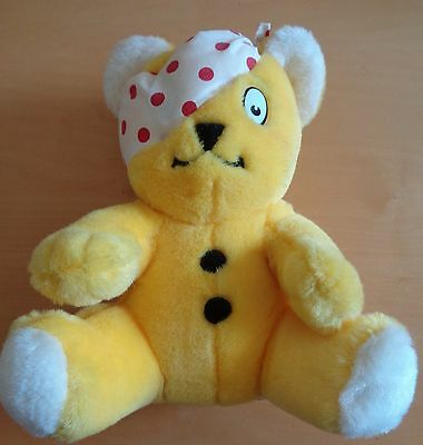 pudsey bear with white and red dot bandage
