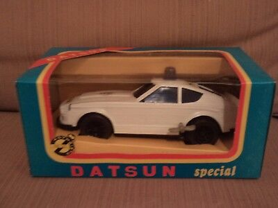Greek vintage toy Datsun  police car no120 made in greece wind up 1970s