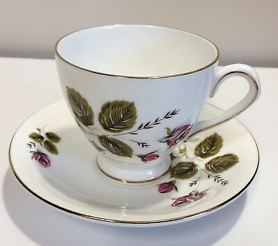 Elizabethan English Tea Cup and Saucer bone china pink rose large green leaves