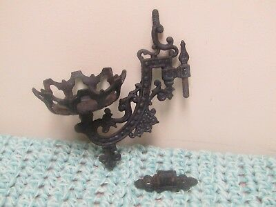 Antique cast iron swivel wall sconce for an oil lamp