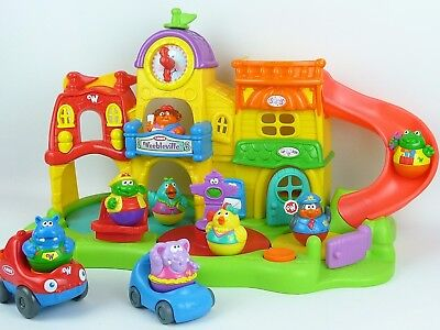 Weebles Weebleville Town Centre Playskool Tested Includes 8 figures and 2 cars.