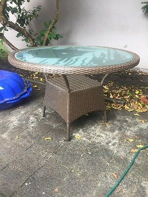 Wicker and glass outdoor tabl