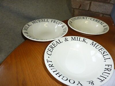 three unbrandde white pottrey dishes with writing around the edge