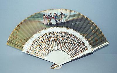 A Highly Decorated Fan With A Wooden Frame.