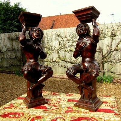 A pair of carved walnut jesters: Mid C19th. French.