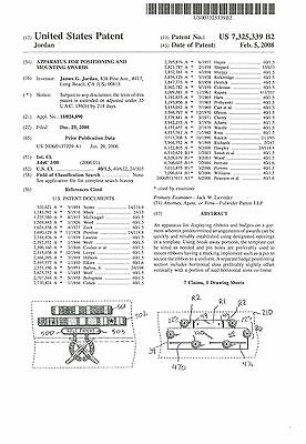 apparatus for positioning and mounting awards u.s. pat# 7,325,339