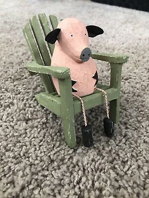Wooden Pig In Chair