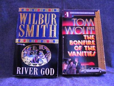2 Fiction Book Lot - Wilbur Smith River God, Tom Wolfe Bonfire of the Vanities