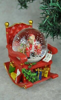 Festive Christmas Santa and his Rocking Chair Snow Globe