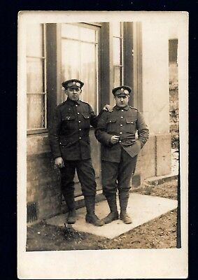 WW1 RP Postcard  of a pair of uniformed  soldiers