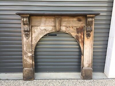 antique wooden fire surround and mantel