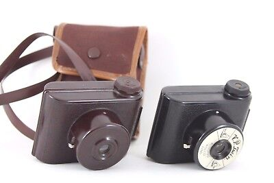 TWO x VP twin bakelite cameras, one black, one brown, and a case,shutters fire