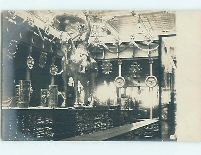 old rppc HORSE AND RIDER STATUE INSIDE BUILDING HM0904