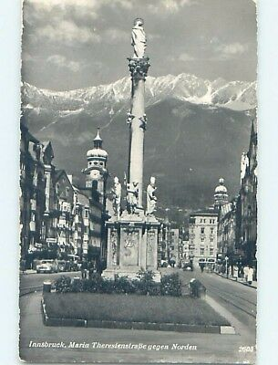 old rppc CARS AND BUILDINGS BY STATUE Innsbruck Austria HM1446