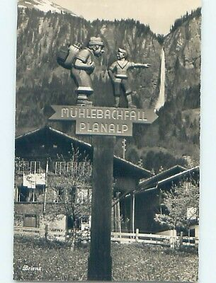 old rppc CARVED WOODEN FIGURES ON SIGN Interlaken Switzerland HM1549