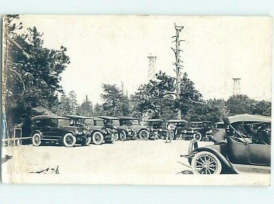 Damaged Back Pre-1930 rppc MANY ANTIQUE AUTOMOBILE CARS IN PARKING LOT HM0338