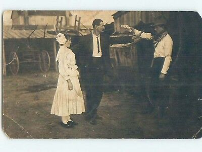 Pre-1920's rppc western MAN PROTECTS WOMAN FROM OUTLAW WITH HANDGUN GUN HM0632
