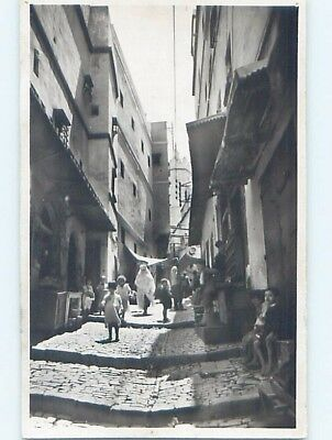 old rppc PEOPLE AND SHOPS IN THE STREET country of Algeria HM1389