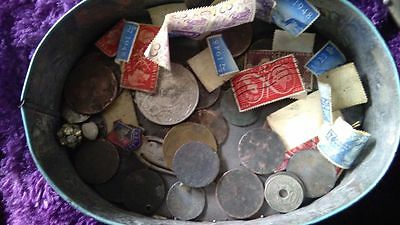 Old Coins And Stamps In A Tin