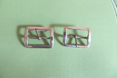 Two solid brass belt buckles