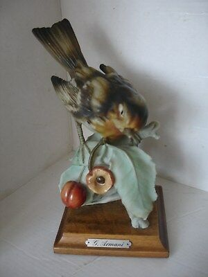 Pretty Capodimonte G.Armani Sparrow bird on a wooden plinth.