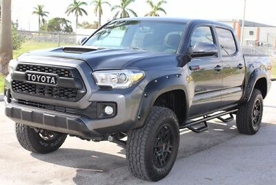 2017 Toyota Tacoma  2017 Toyota Tacoma TRD 4x4 2 k miles Loaded Save Lifted Wheels New Tires SALVAGE