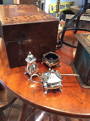 silverplated 3 piece cruet set with blue glass liners