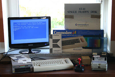 Geprüftes Commodore 64-Set: C64, Floppy, Joystick, Disketten, Fastload-Modul