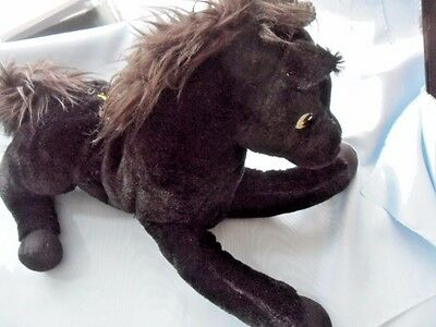 "Pony/ horse soft toy.Black plush material Pony/horse laying down 14"" x 8"