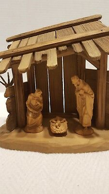"Anri Nativity set 4 pieces including a manger. Pieces are 3'', 2 1/4"" and 1 1/4"""