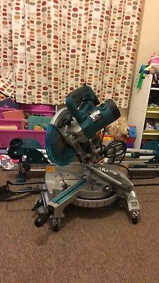 Makita Ls1018L mitre chop saw 110v with makita stand . Used once!!