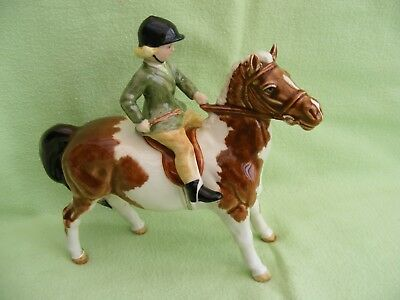 Beswick Girl on a Skewbald pony girls head looking down No 1499