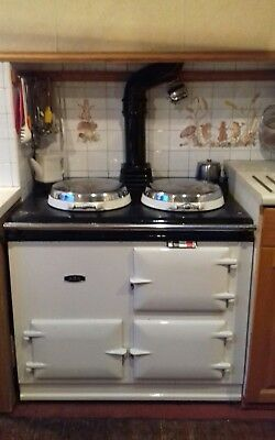 Aga, two-oven, oil-fired, white, provides cooking and hot water, dismantled.