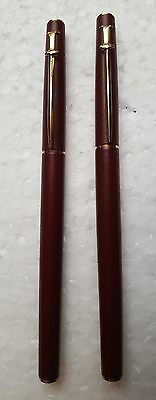VINTAGE CARAN d'ACHE ROLLER BALL & FOUNTAIN PENS IN BURGUNDY WITH GOLD TRIM