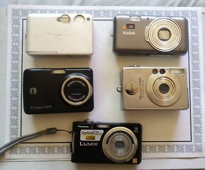 A lot of 5 digital Cameras parts or repair, NO CHARGERS NO BATTERIES