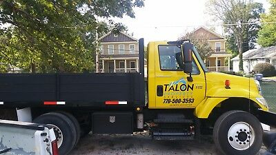 2004 7300 DT 466  International flat bed dump truck $36.500.00 OBO