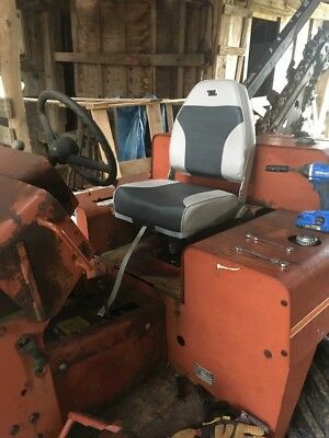 Ditch Witch 4010 including Backhoe, Blade, Trencher, and Earth Saw