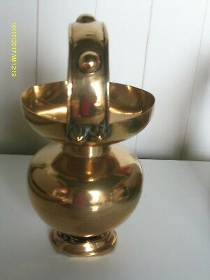 Vintage brass  bud vase with handle 27cm high standing on an 8cm base